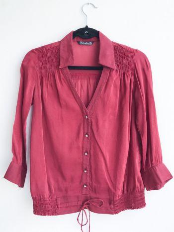 Blusa color rojo quemado