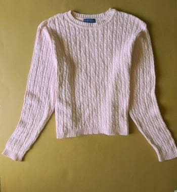 Suéter de punto rosa